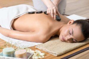 women receiving hot stone massage